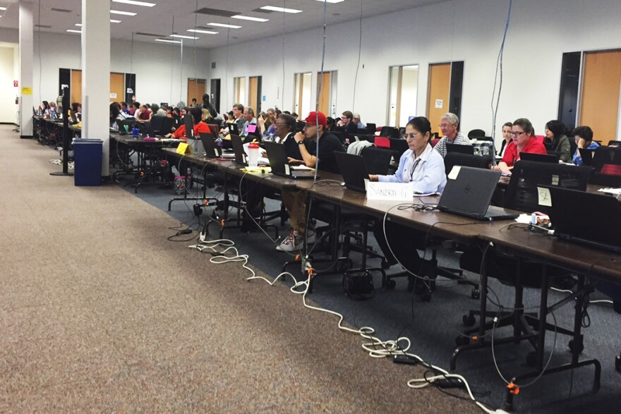 Scorers look over PARCC tests at a Pearson facility in San Antonio, Texas.