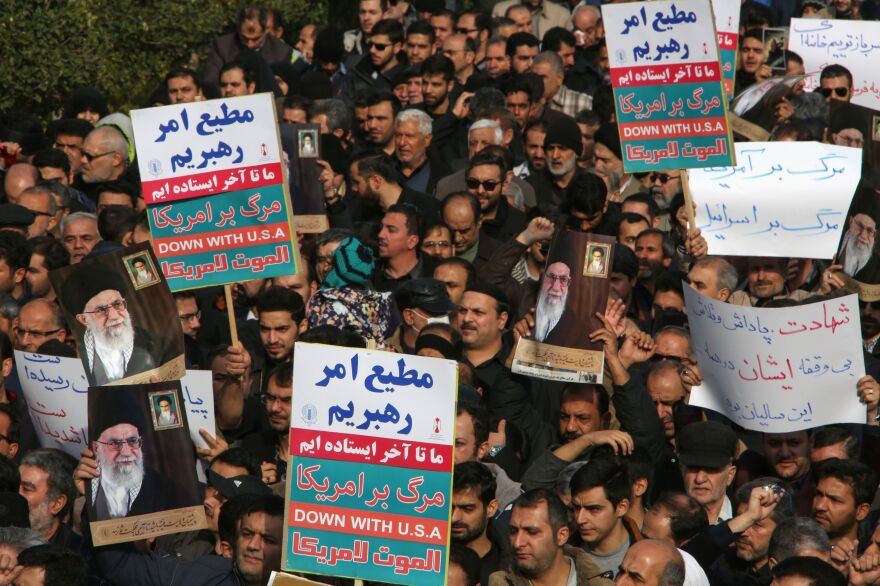 Iranians hold anti-U.S. banners during a demonstration in the capital, Tehran, following the killing of Qasem Soleimani by a U.S. drone strike.
