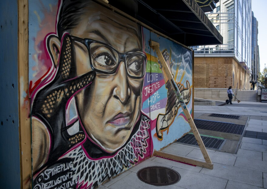 In Washington, D.C., a mural of Ruth Bader Ginsburg on boards protecting a building on I street in preparation for possible protests after the election tomorrow.