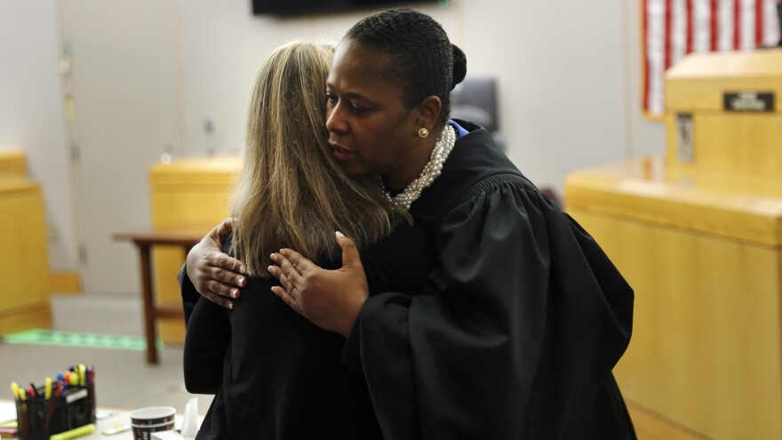 Judge Tammy Kemp gives former Dallas police officer Amber Guyger a hug after sentencing her to 10 years in prison.