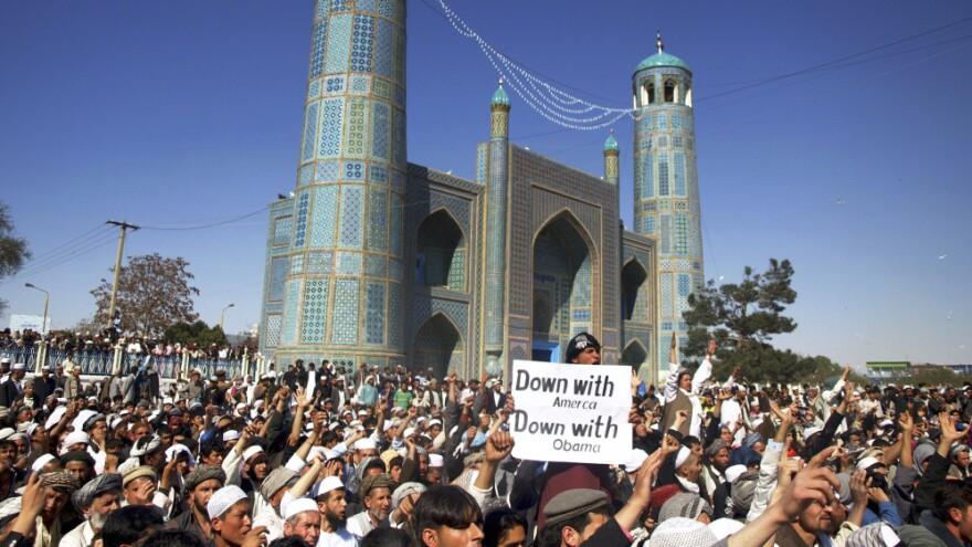 Afghans chant anti-U.S. slogans during a demonstration   in Mazar-i-Sharif, north of Kabul, on Friday.