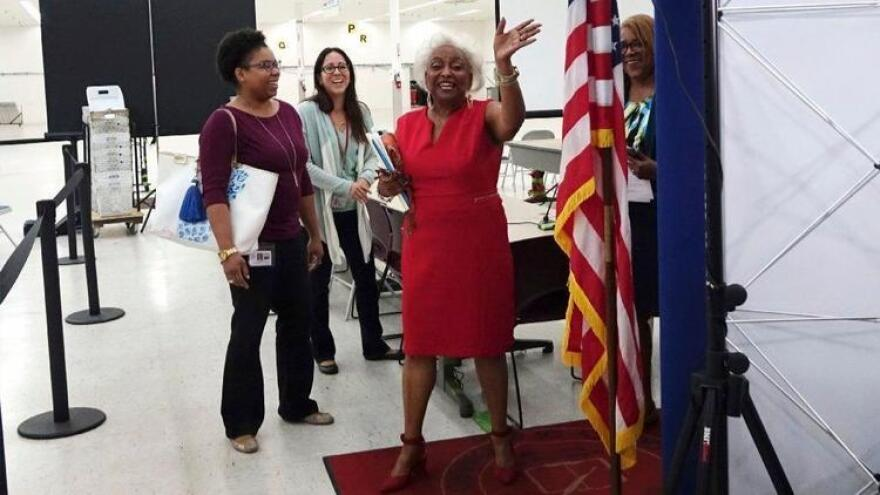 Broward Supervisor of Elections Dr. Brenda C. Snipes waves goodbye to the media, Sunday, Nov. 18, 2018, at the Broward Supervisor of Elections office in Lauderhill. She planned to resign next month but was suspended by Gov. Rick Scott.