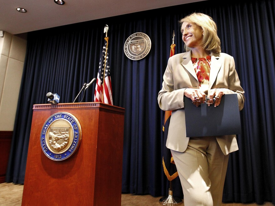 """Arizona Republican Gov. Jan Brewer leaves a podium at the state Capitol in Phoenix after responding to President Obama's immigration speech on June 15. Brewer said the speech represented a """"pre-emptive strike"""" aimed at what then was an upcoming Supreme Court ruling on Arizona's immigration law."""