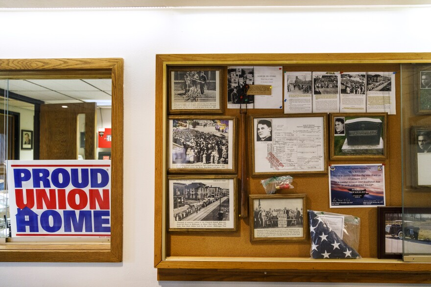 A display case at the UAW Local 833 union hall lobby in Sheboygan holds memorabilia of past Kohler strikes.