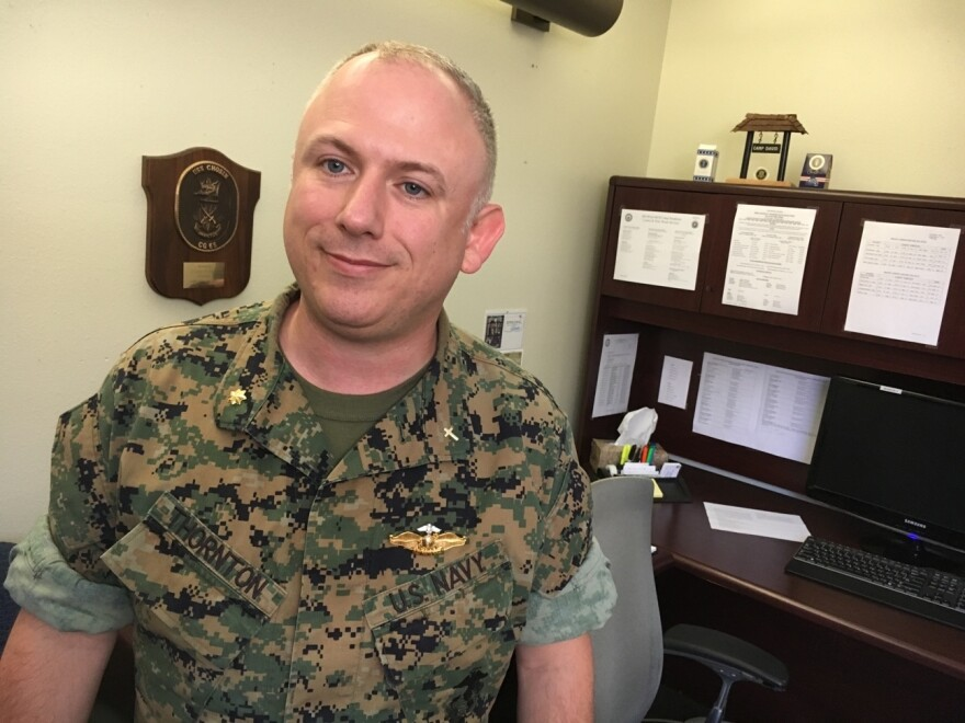 """Lt. Cmdr. Corey Thornton is the chaplain at the Camp Pendleton Marine Base and helps facilitate the church groups that run the on-base food pantries for military families. """"The Marine Corps sees family readiness as integral to the mission itself,"""" he says. """"If the family is not OK, then the Marine that's serving in that command is not OK."""""""