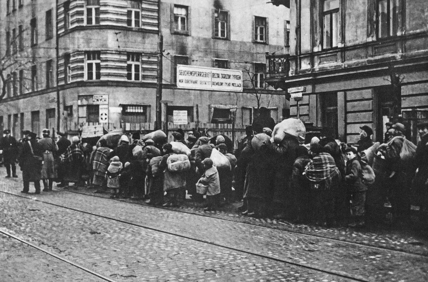 The forced resettlement of Jews from villages and small cities in Warsaw District to the Warsaw ghetto. This photo was taken near the crossing of Zelazna and Solidarnosci streets.