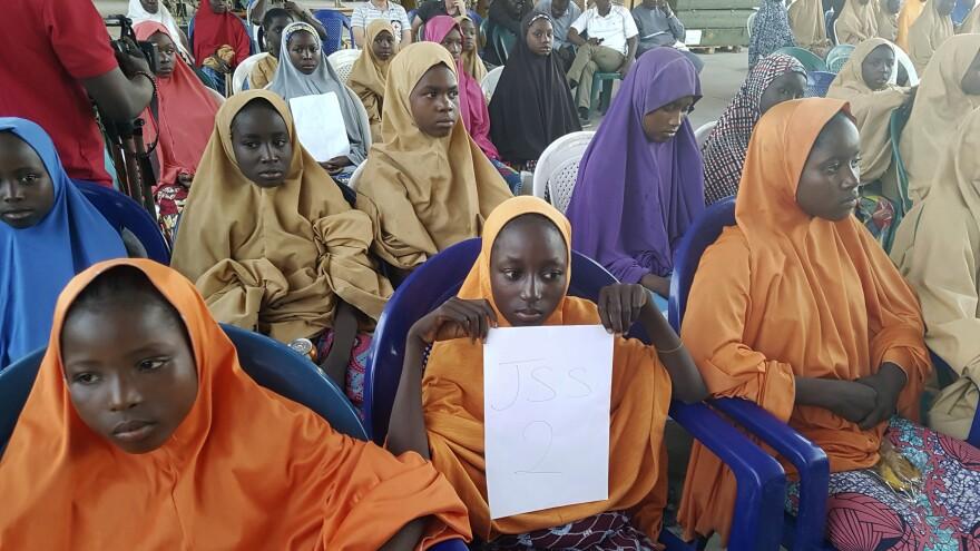 School girls set free by their Boko Haram kidnappers are photographed during a handover to government officials in Maiduguri on Wednesday.