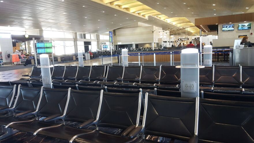 Empty chairs in an empty terminal at Tampa International Airport.
