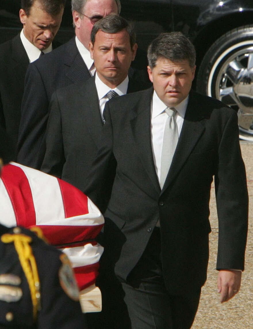 Supreme Court Chief Justice nominee John Roberts, second from right, joins other former law clerks of the late Supreme Court Justice William Rehnquist as they carry his coffin into the Supreme Court in Sept. 2005.