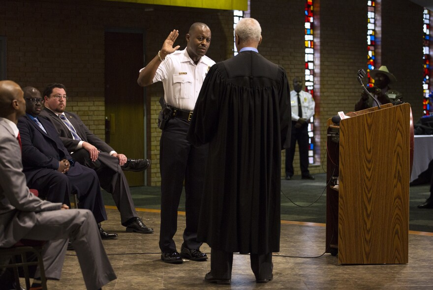 Delrish Moss is sworn in as Ferguson's new police chief at a ceremony at the Ferguson Community Center's event space on Monday afternoon.