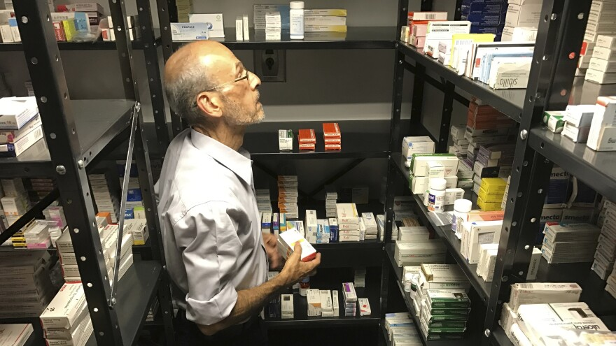 A volunteer from the non-profit Accion Solidaria organizes imported medicines alphabetically, in a store room in Caracas, Venezuela, last April. The Pharmaceutical Federation of Venezuela estimates the country is suffering from an 85 percent shortage of medicine.