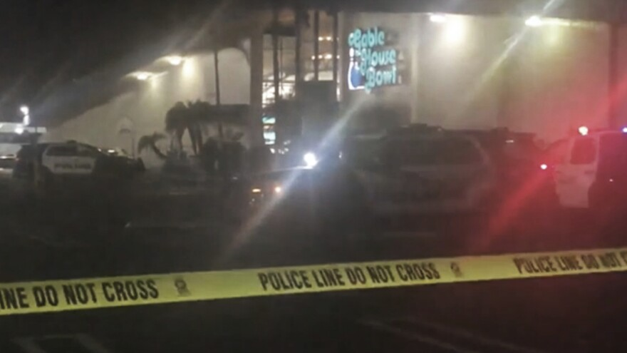 Police cordon off the scene of a shooting at a bowling alley in a Los Angeles suburb early on Saturday.