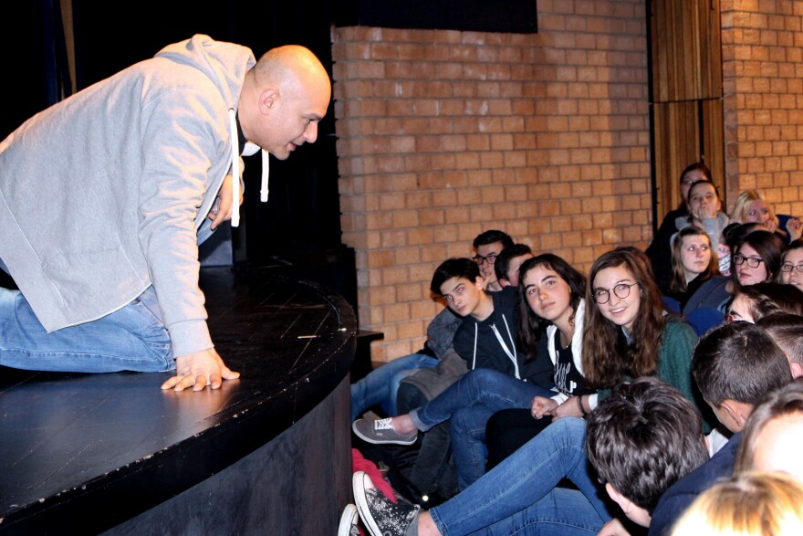 Belgian actor Shark Carrera, who plays a Lebanese Christian in the play <em>Djihad</em>,<em> </em>talks with students from the Collège Notre Dame de Bon Secours in Binche, Belgium, after a performance on Jan. 7.