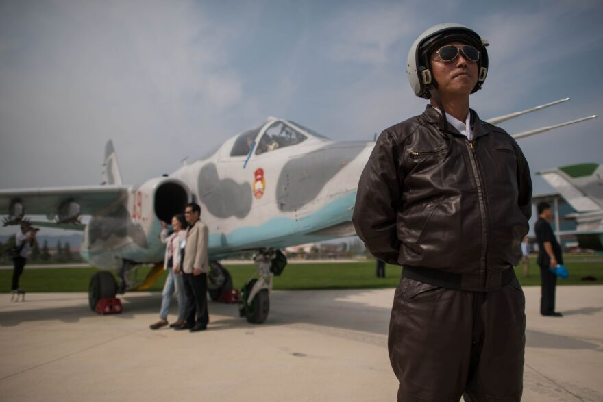 A pilot poses with a Sukhoi Su-25 aircraft during the second day of the Wonsan Friendship Air Festival in Wonsan in Sept.  2016. North Korea's air force is out-of-date, according to experts.