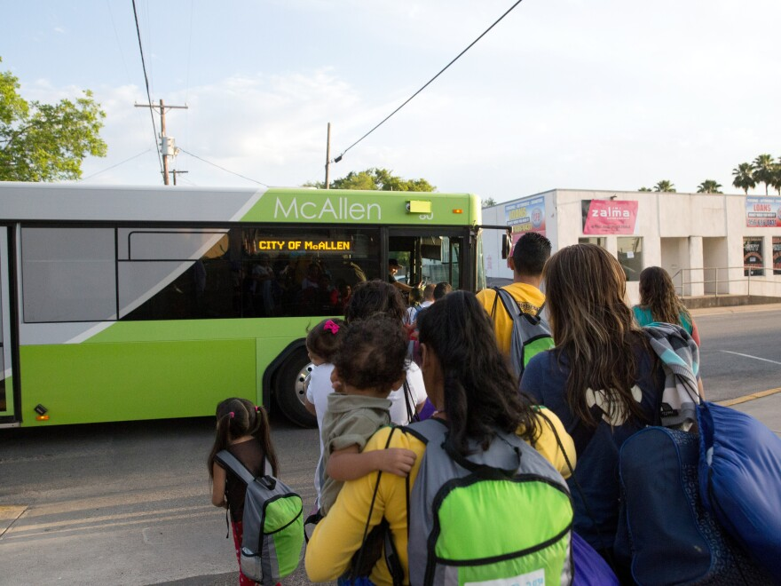 Immigrant families board a bus headed to the downtown bus station in McAllen, Texas, after being released by the Border Patrol.
