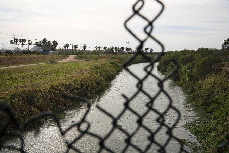 Temporary immigration court facilities (left) have been erected on the U.S. side of the Rio Grande. The Trump Administration is using them to speed up the adjudication of asylum applicants waiting in Mexico.