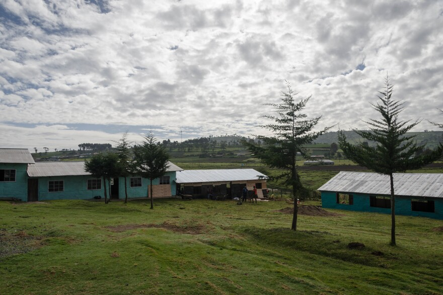 The group added two classrooms onto a church-run school in a rural village, so it can add seventh and eighth grade.