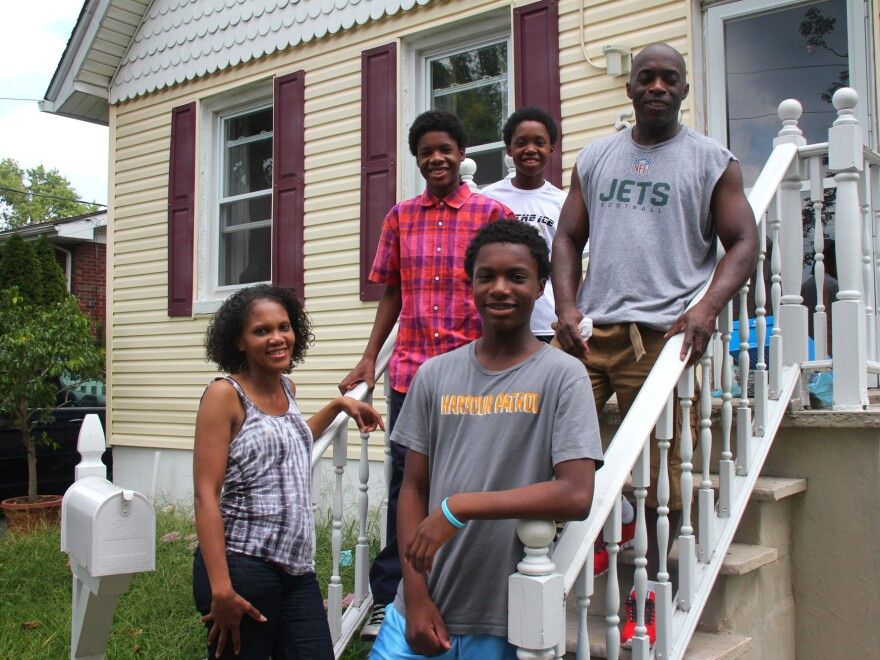 Monique Coleman and her family spent years in this house in Woodbridge, N.J., enduring floods that filled their basement with water. Now the state of New Jersey, using federal funds, has bought their home, and they've moved to a less vulnerable area.