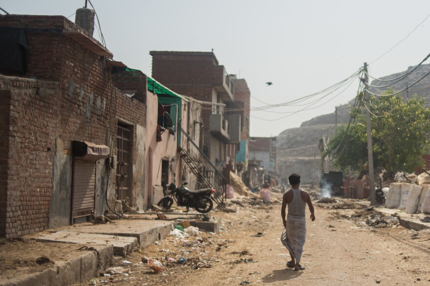 Sheikh Rahim, 36, walks from the slum where he lives, up to the Ghazipur landfill, where he scavenges plastic to sell to recyclers.