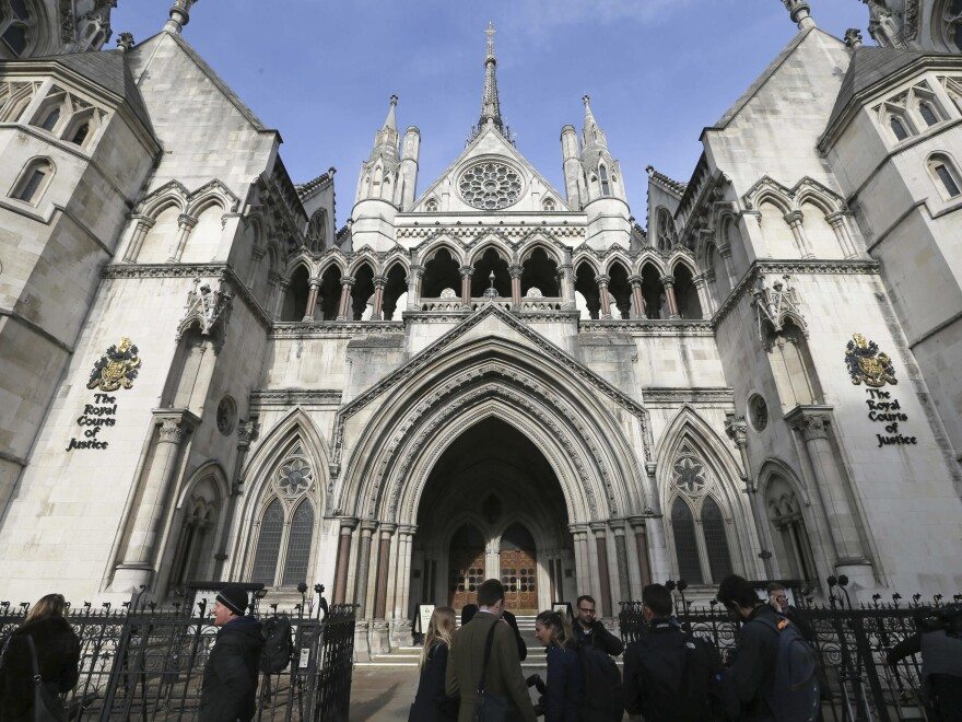 Media gather outside the High Court in London on Thursday for the decision on the challenge to plans for Brexit.