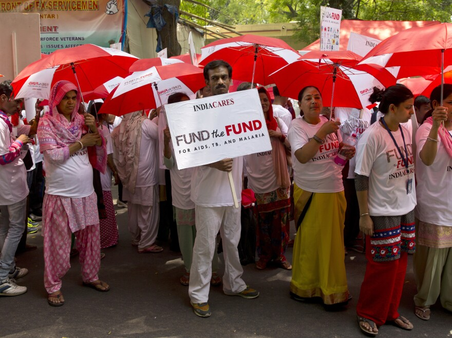 Activists at a rally urge China, Germany and Japan to step up their contributions to the Global Fund to fight AIDS, tuberculosis and malaria, in New Delhi, India, on May 10.