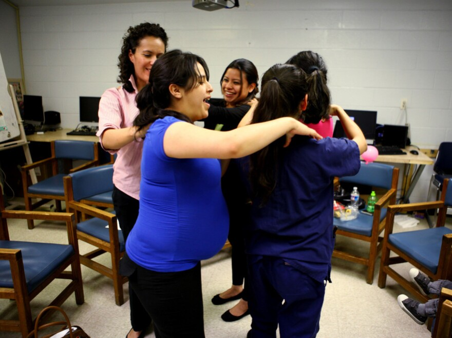 """Members of the group give each other a back massage during the class. The woman who created the centering model, Sharon Schindler Rising, says """"there's tremendous power in the group."""""""