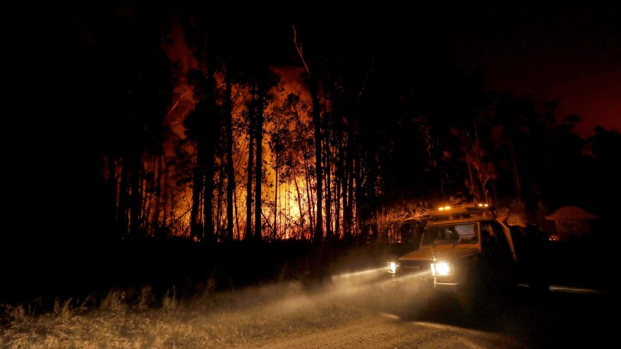 Fire response crews monitor the blazes Thursday in East Gippsland, Australia, where deadly bushfires have destroyed properties and prompted warnings from local authorities.