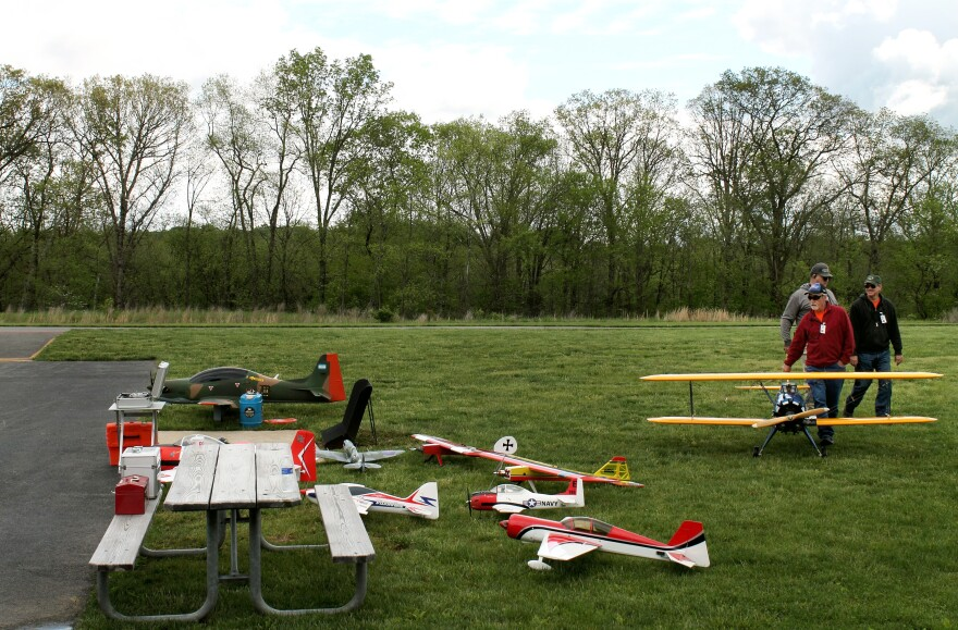 Model airplanes cluster near the runway on a flying field in Boyds, Md.