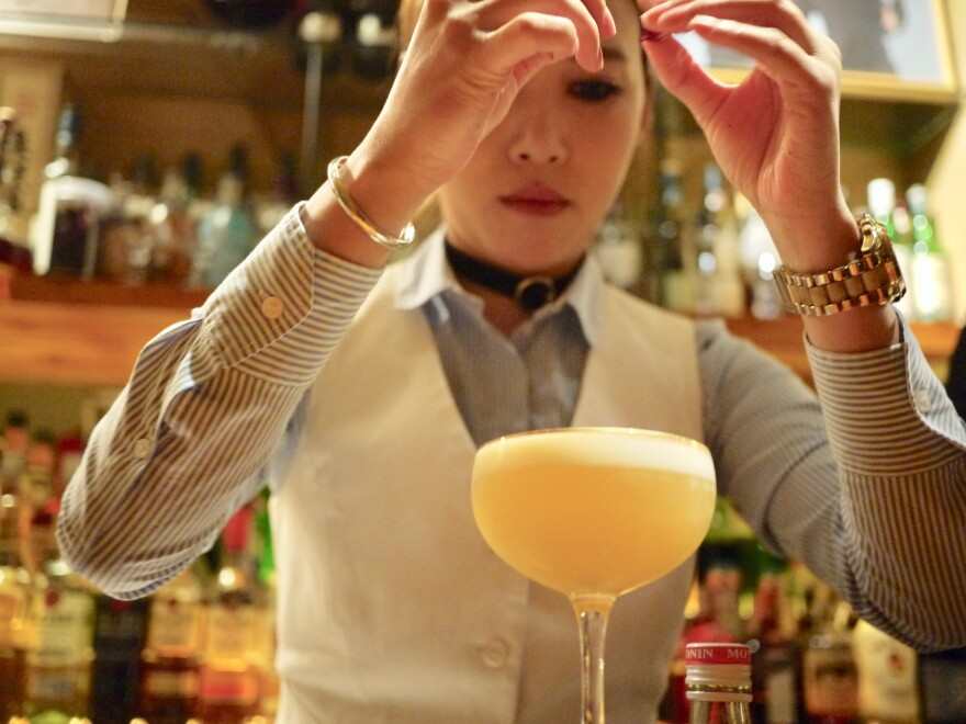Moe mixes a Korean sour at her bar, Moju, in Shanghai. In October, she won an international cocktail competition for her signature drink, the sakura.