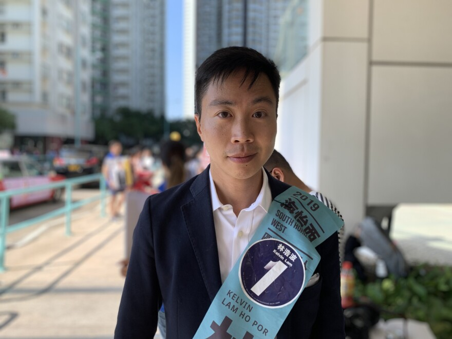 "Kelvin Lam, a pan-democratic candidate, is running in lieu of activist Joshua Wong, who was disqualified in October. ""We want a more transparent structure for all the meetings,"" he says."