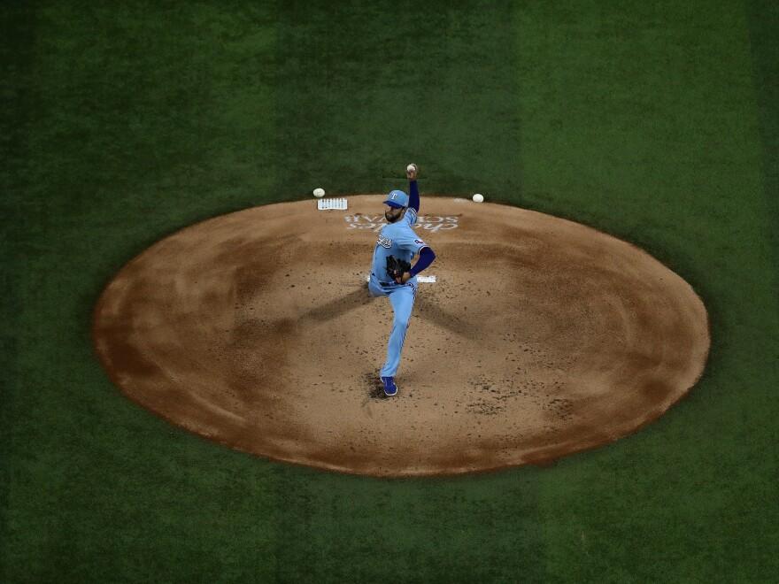 Jordan Lyles of the Texas Rangers throws against the Houston Astros on the final game of the regular season on September 27, 2020.