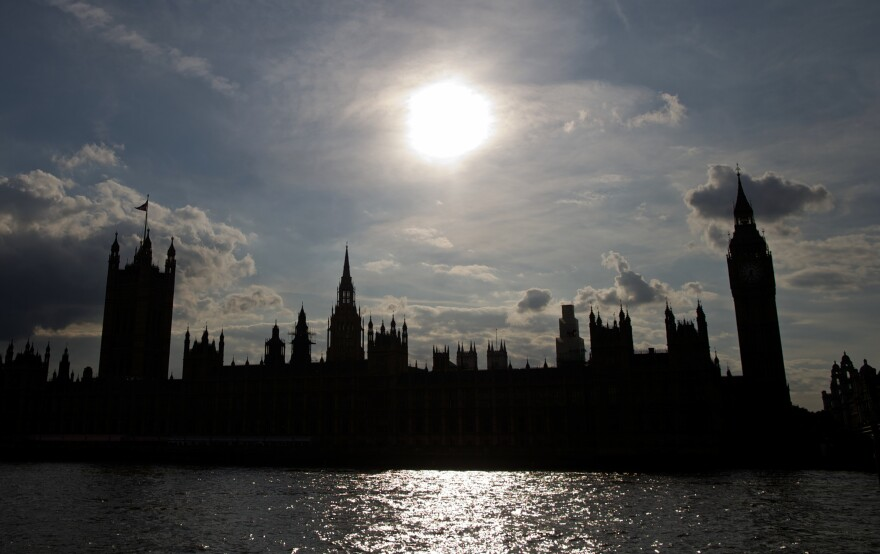 The Houses of Parliament are silhouetted against a setting sun as lawmakers debate possible British military action in Syria.