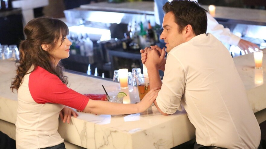 Jess (Zooey Deschanel) and Nick (Jake Johnson) have one of their many chats on Fox's <em>New Girl</em>.