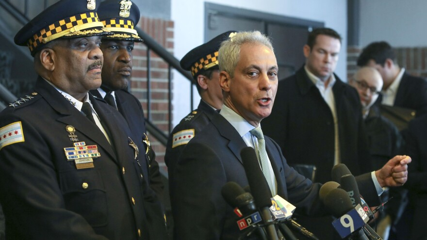 Chicago Mayor Rahm Emanuel offers a scathing critique of prosecutors' decision to drop the charges Tuesday, as Chicago Police Superintendent Eddie Johnson (far left) watches.