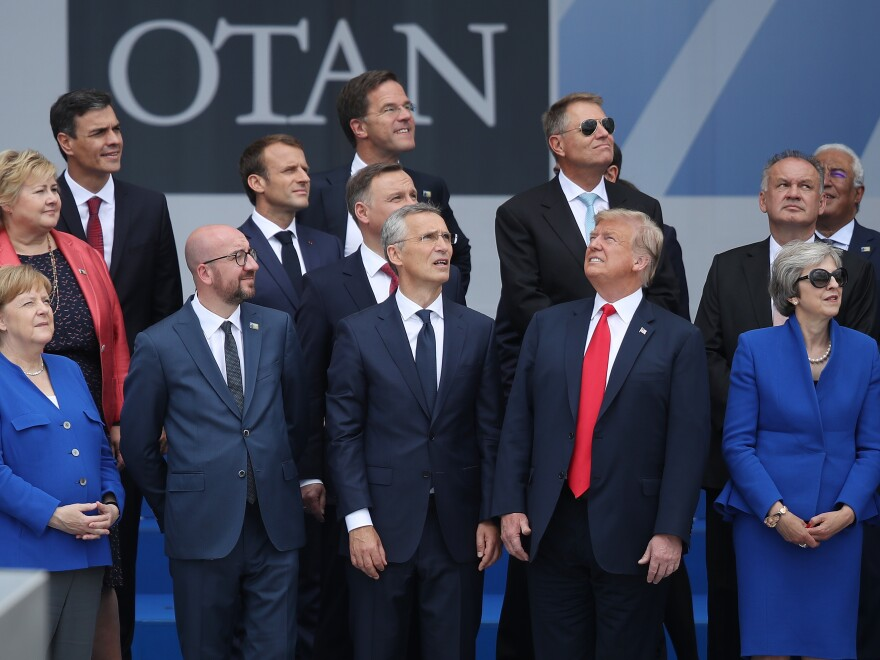 German Chancellor Angela Merkel (front left), Belgian Prime Minister Charles Michel, NATO Secretary-General Jens Stoltenberg, President Trump and British Prime Minister Theresa May attend the opening ceremony at the NATO summit Tuesday in Brussels.