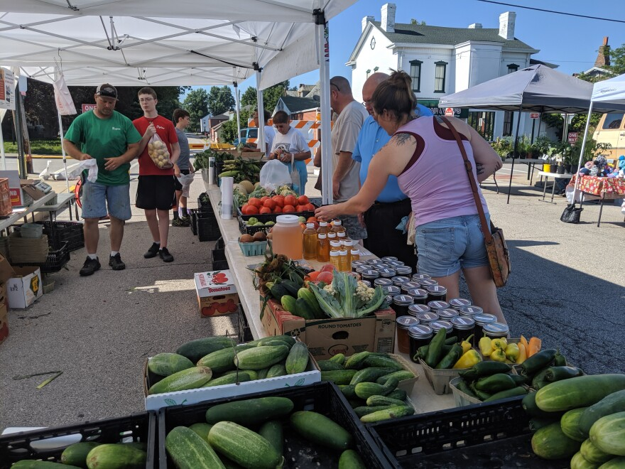 Visitors look over produce at one stand at the Old Town Farmers Market on July 20. The Belleville market started accepting SNAP benefits this year.
