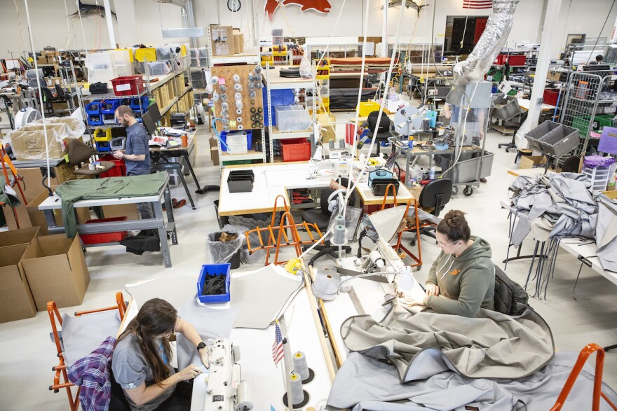 Workers at Simms, a fly fishing gear manufacturing company, make heavy duty medical gowns in Four Corners, Montana in June, 2020.