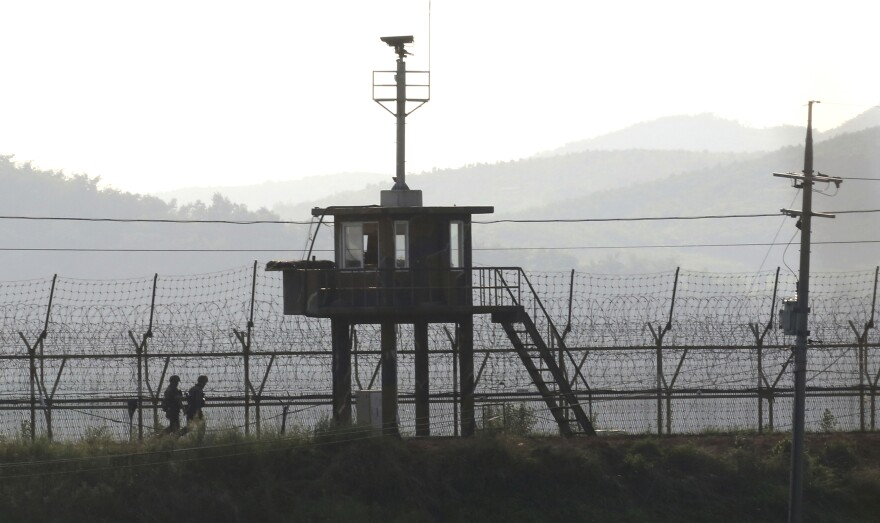 South Korean army soldiers patrol on Monday along the barbed-wire fence in Paju, near the border with North Korea.