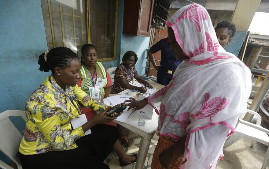 Semiu Taiwo, right, gets her biometric reading taken on March 7 in Lagos, Nigeria, during an exercise organized by the Independent National Electoral Commission to test run smart card readers that are to be used for the Nigerian general election.