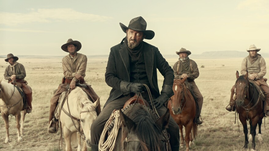"Ralph Ineson plays ""the man in black"" in ""Near Algodones,"" the second segment of the Western anthology <em>The Ballad of Buster Scruggs</em>. Beginning Nov. 16, the film will play in theaters for a week before it becomes available for streaming on Netflix."