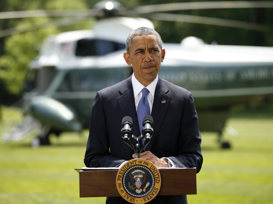 President Obama ruled out sending ground troops to Iraq, saying any U.S. action must be accompanied by Iraqi political action.