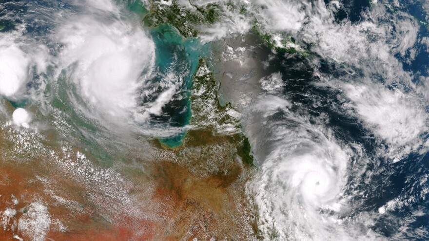 Cyclones Lam and Marcia, before they made landfall in Australia on Thursday.
