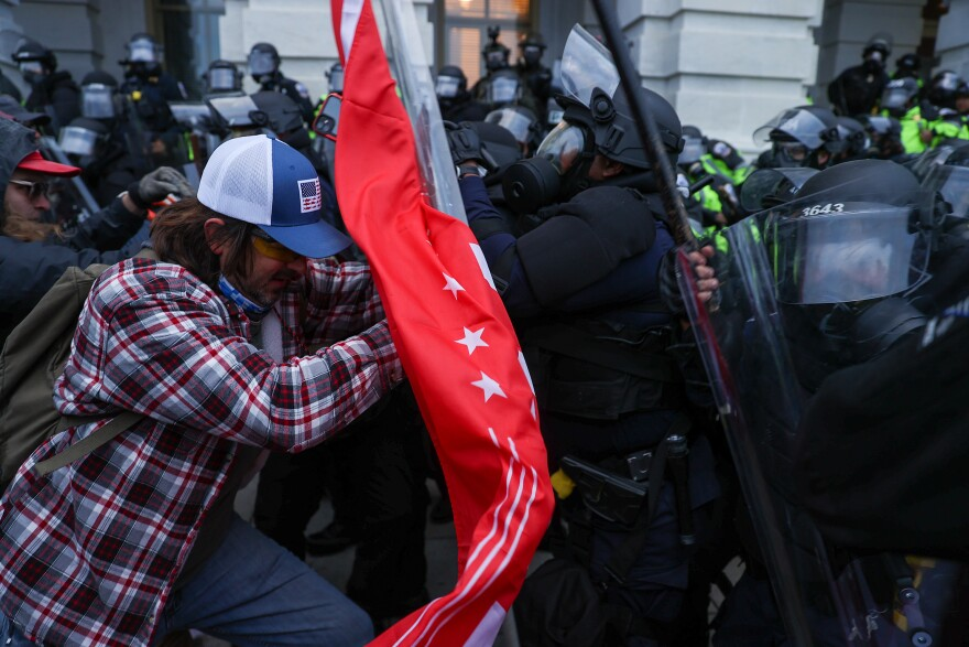 Security forces clash with President Trump's extremist supporters after they breached the U.S. Capitol security in Washington, D.C. on Jan. 6. (Tayfun Coskun/Anadolu Agency via Getty Images)