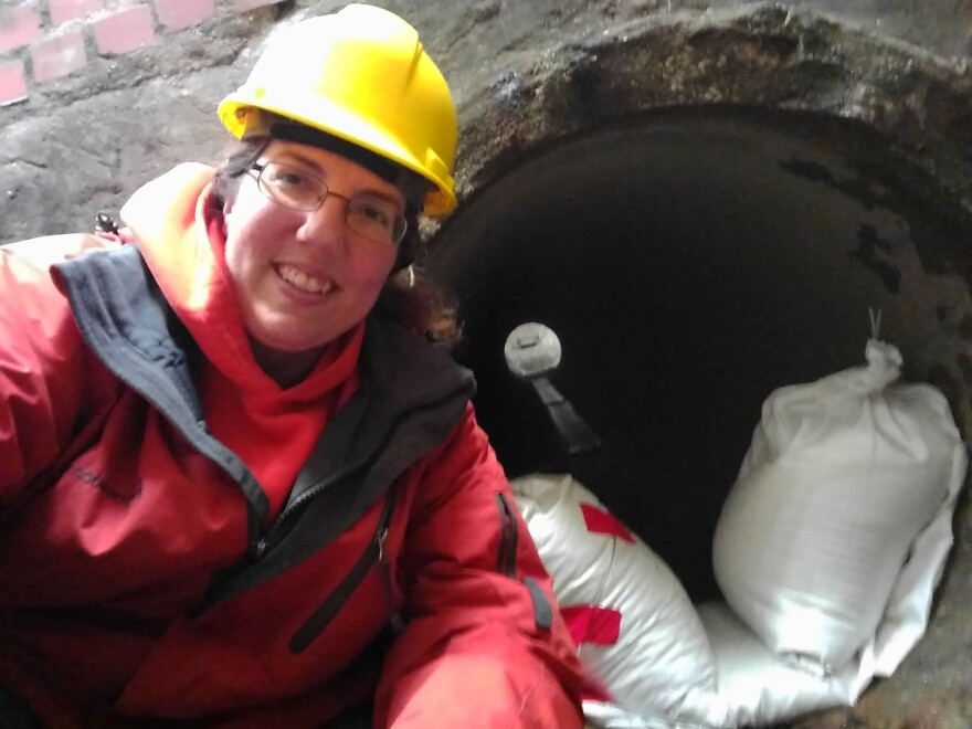Danelle Haake installs a data logger in a stormwater drain on December 13, 2016. The SLU grad student monitored saltwater runoff in six St. Louis County cities for two winters.