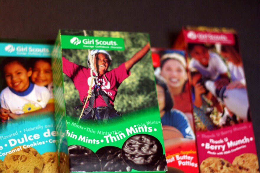 Photo of girl scout cookie boxes.