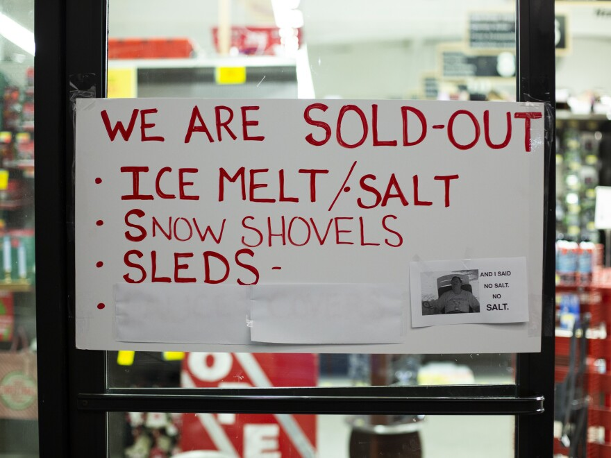 A sign at a Seattle hardware store warns customers that there is no remaining ice melt, salt, snow shovels, or sleds for sale.