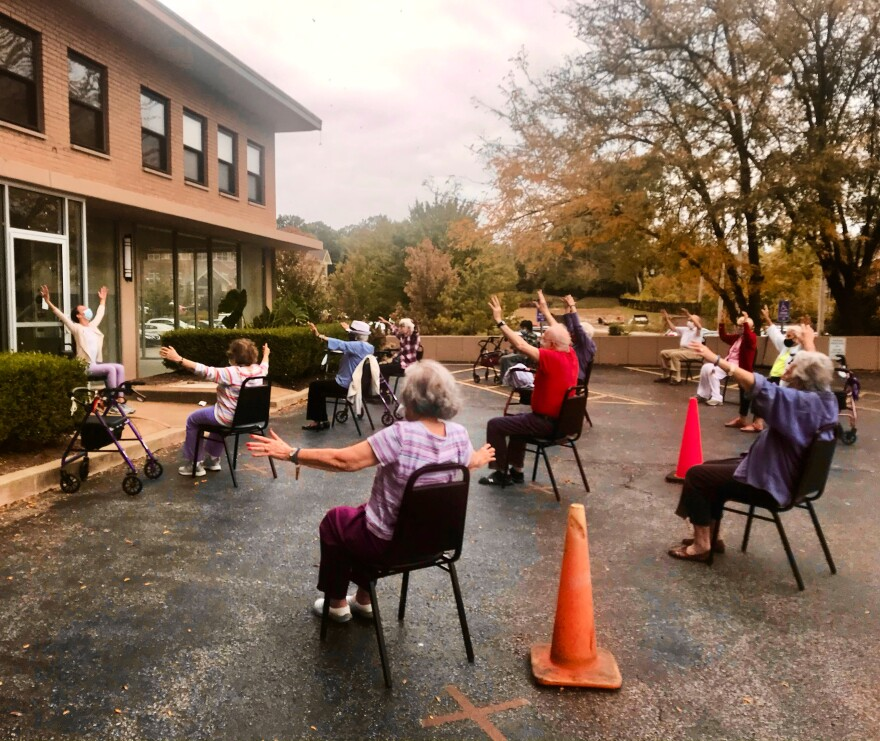 Vanessa Woods teaches an outdoor, socially distant class with older adults.