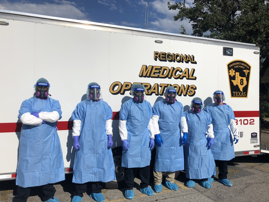 Paramedics from the San Antonio Fire Department set up swabbing stations in a suburban nursing home's parking lot as part of the massive state intervention to stop the spread of infections in Texas nursing homes.