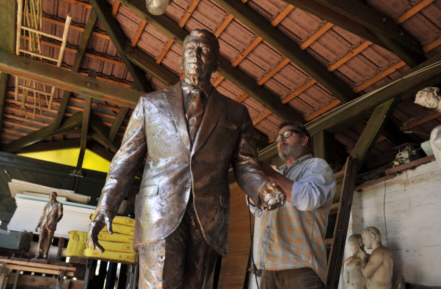 Hungarian sculptor Istvan Mate finishes up work on his statue of late U.S. President Ronald Reagan in his workshop in the town of Csongrad, Hungary, Sunday, June 26, 2011.