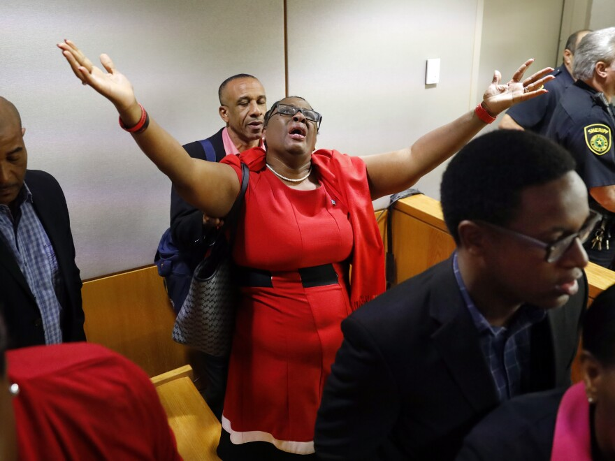 Botham Jean's mother, Allison Jean, rejoices in the courtroom after fired Dallas police Officer Amber Guyger was found guilty of murder.